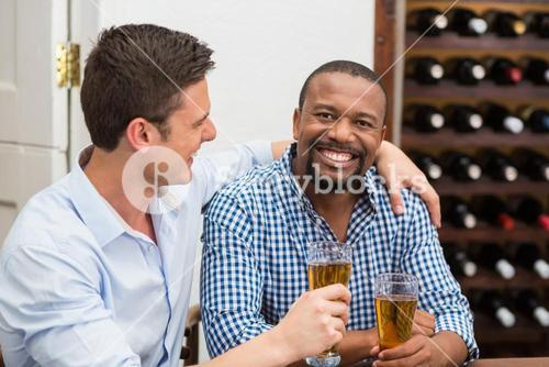 Friends laughing while having beer