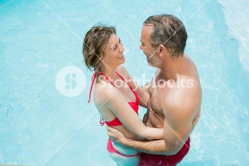 Couple romancing in swimming pool