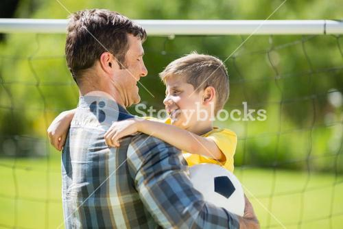 Father hugging son in the park