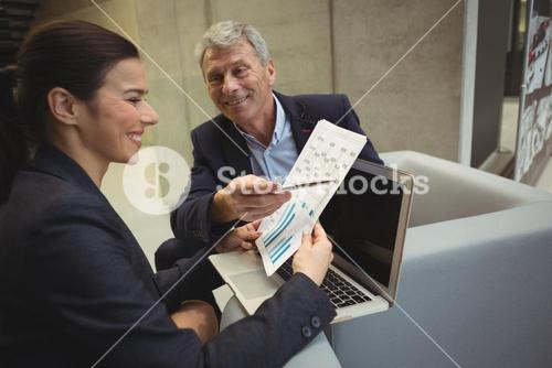 Business executives analyzing reports
