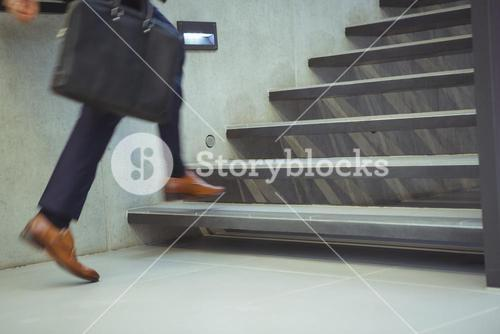 Businessman climbing stairs at office