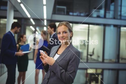 Businesswoman using digital tablet in the passageway