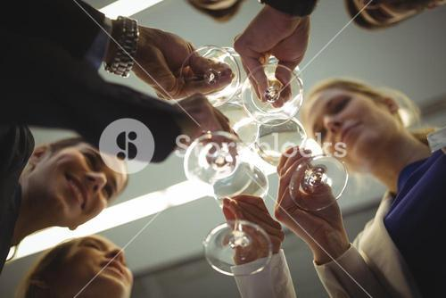 Businesspeople toasting glasses of champagne