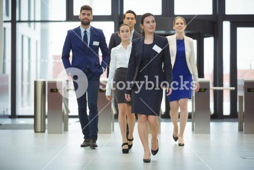 Businesspeople walking in a lobby