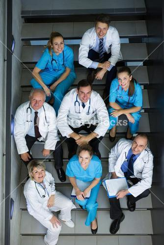 High angle view of doctors and surgeons sitting on staircase