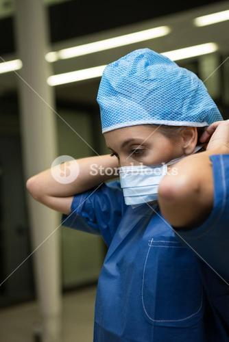 Female surgeon wearing surgical mask