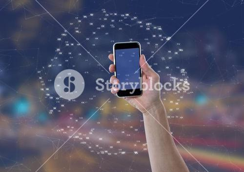 Holding mobile phone against Night city with connectors