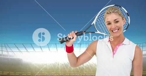 Tennis player smiling against stadium with bright lights and blue sky