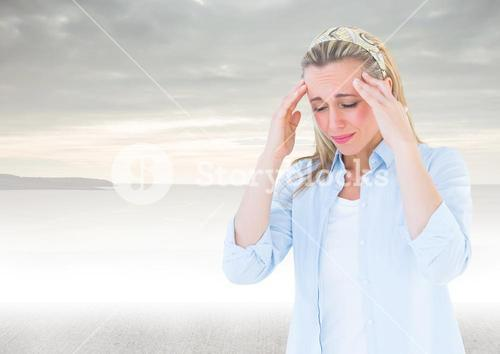 Stressed woman headache in front of sea
