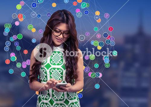 Woman touching phone against Night city with connectors