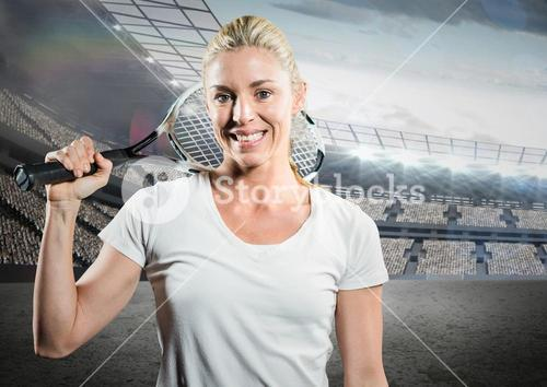 Tennis player smiling against stadium with bright lights and audience
