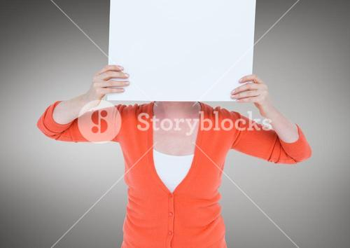 Woman in orange cardigan with blank card over face against grey background