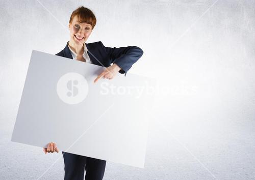 Business woman with large card against white background