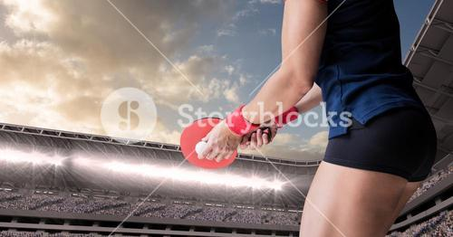 Table tennis player lower body against stadium and sky with clouds