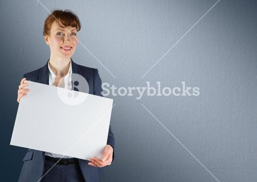 Business woman with blank card against navy back