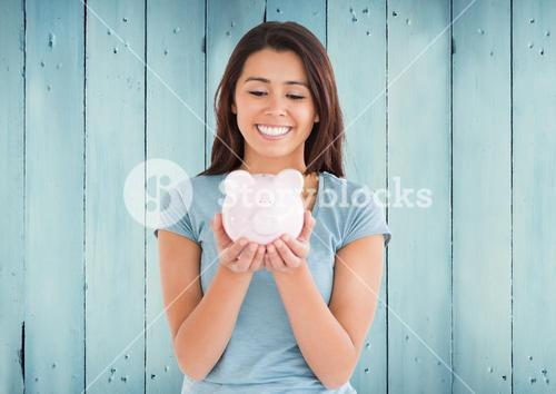 Woman with piggy bank against blue wood panel