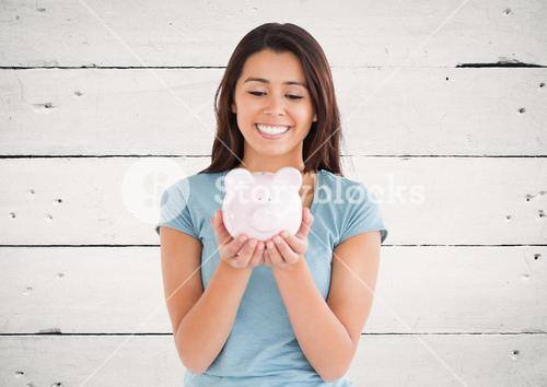 Woman with piggy bank against white wood panel