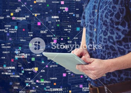 Man with tablet against Night city with connectors