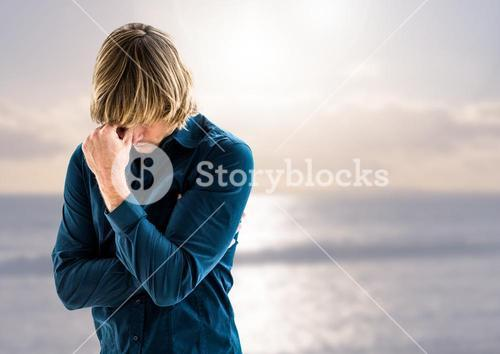 Sad depressed man in front of sea