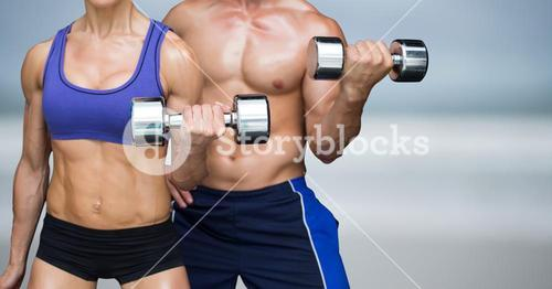 Man and woman weight lifting on blurry beach