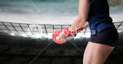 Table tennis player lower body against stadium  with bright lights