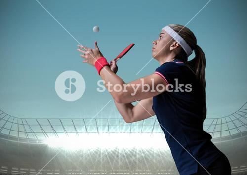 Table tennis player against blue sky and stadium
