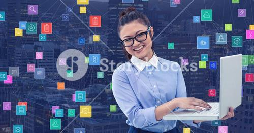 Businesswoman with laptop against Night city with connectors
