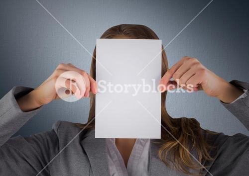 Business woman with blank card over face against navy background