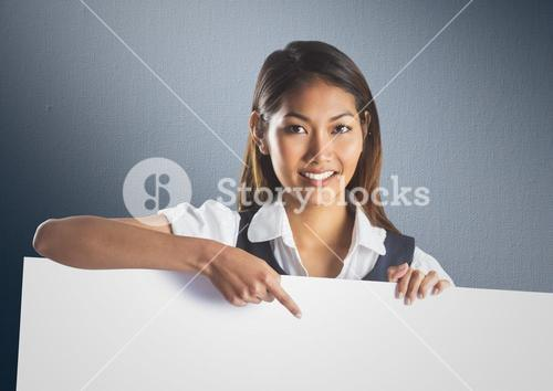 Business woman with large blank card against navy back