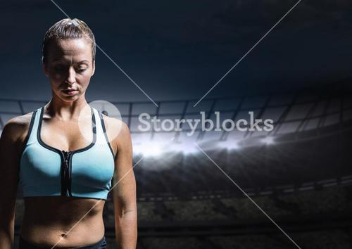 Sad disappointed woman athlete against staadium background