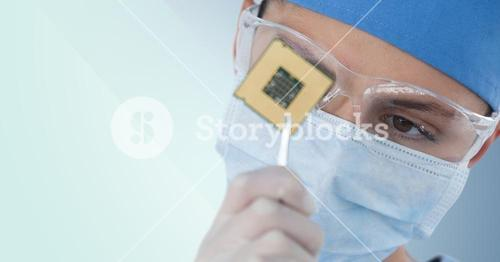 Close up of woman with electronics and mask against blue background