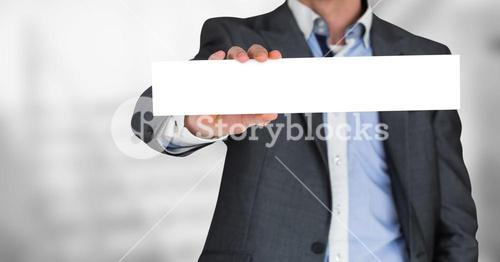 Business man mid section with blank card against blurry grey stairs