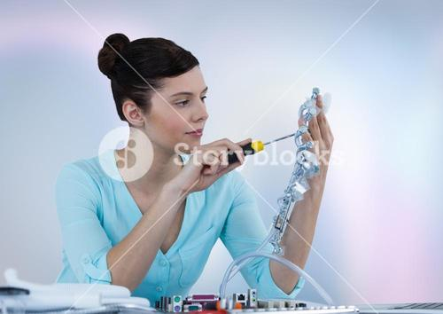Woman with electronics against blurry background
