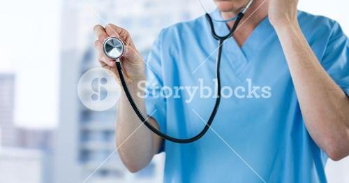 Nurse with stethoscope mid section against blurry buildings