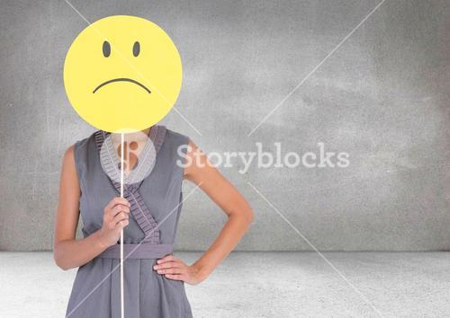 Sad woman holding face against grey background