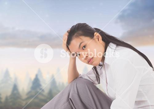Tired disappointed young woman against magical sky