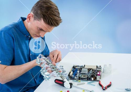 Man with electronics against blue blurry background