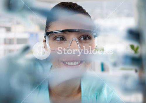 Close up of woman through electronics in office