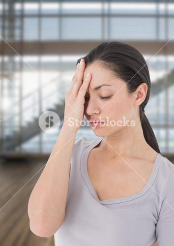 Stressed woman against bright windows