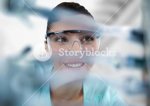 Close up of woman through electronics against blurry background