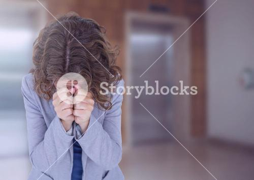 Woman crying in front of elevators