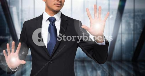 Business man mid section with flares on hands against blurry window