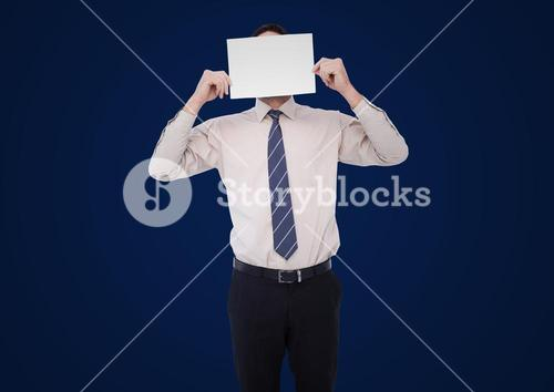 Business man holding blank card over face against navy background