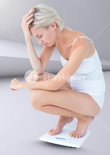 Sad woman on weighing scales against minimal background