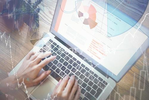 Hands of woman using laptop