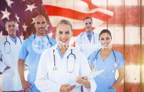 Composite image of confident female doctor with team over white background