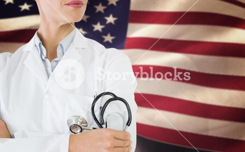 Composite image of mid section of a female doctor with stethoscope in hospital