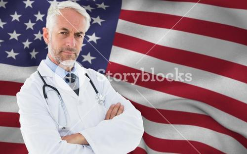 Composite image of portrait of a serious confident male doctor at medical office