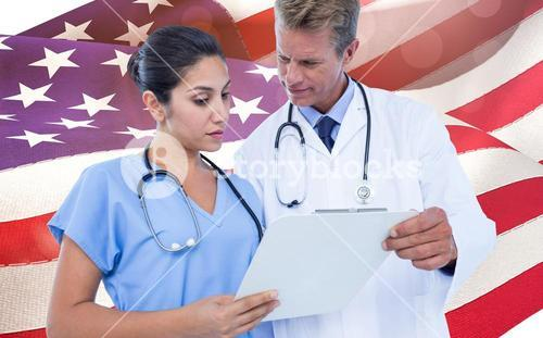 Composite image of male doctor with nurse discussing over clipboard