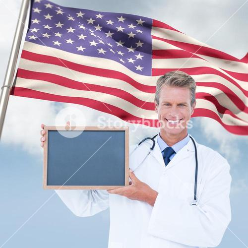 Composite image of portrait of smiling male doctor holding blank slate